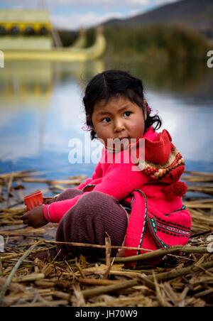 UROS ISLANDS, PERU - CIRCA October 2015: Girl from the Uros Islands in Lake Titicaca. - Stock Photo