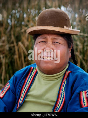 UROS ISLANDS, PERU - CIRCA October 2015: Portrait of woman from the Uros Islands in Lake Titicaca. - Stock Photo
