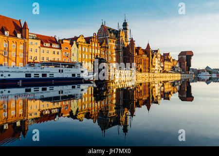 Sunrise view on the riverside of Motlawa river with wonderful buildings of Gdansk old town, Poland - Stock Photo