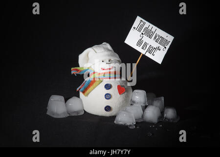Till global warming do us part! The statement written on the protest sign, carried by a snowman, surrounded with - Stock Photo
