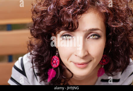Closeup view of cute red haired women smiling - Stock Photo
