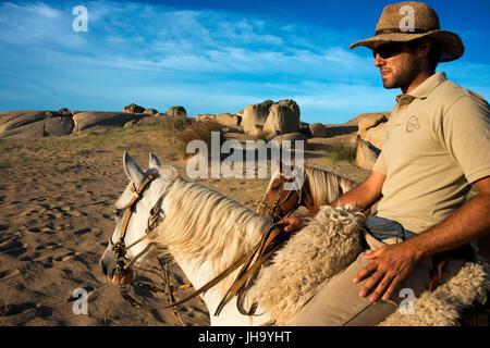 Horse ride from Cabo Polonio to Barra de Valizas, Rocha Department, Uruguay. - Stock Photo