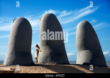 The Hand sculpture of Punta del Este, or Mano de Punta del Este at Parada 4 on the sands of Brava beach, by Mario - Stock Photo