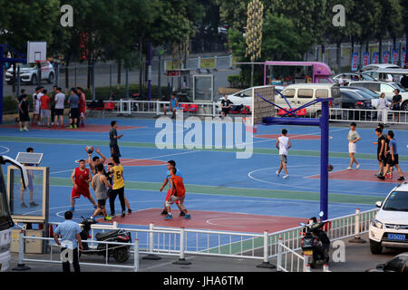 Fuxin, Fuxin, China. 12th July, 2017. Fuxin, CHINA-July 12 2017: (EDITORIAL USE ONLY. CHINA OUT).Kids receive basketball training at a gymnasium in Fuxin, northeast China's Liaoning Province, July 12th, 2017. Fuxin is called as City of Basketball as the local government provides long-term supports for citizens on basketball. The population of Fuxin is about 600,000 and about one third of local citizens play basketball. The local government makes efforts to build basketball gymnasiums and distributes 10,000 basketballs to citizens every year. Credit: SIPA Asia/ZUMA Wire/Alamy Live News Stock Photo