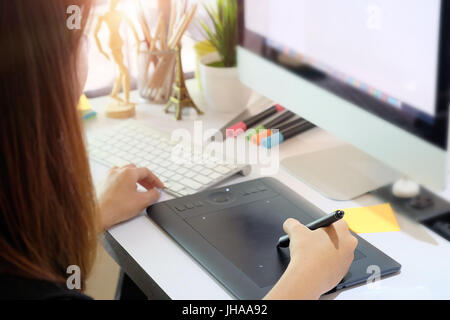 Graphic designer woman working on creative office with create graphic on computer. - Stock Photo