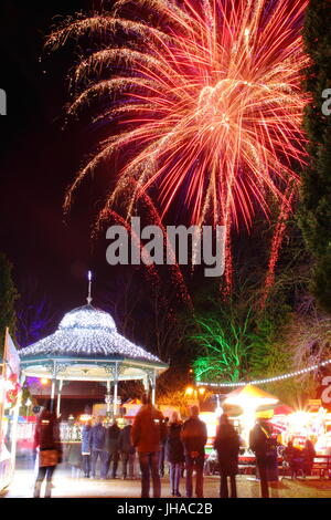 Shoppers pause to see magnificent firework display at Matlock's Victorian Christmas Market in Hall Leys Park, Matlock, - Stock Photo
