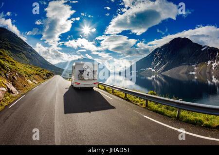 Caravan car travels on the highway.