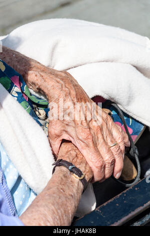 Hands of elderly senior woman in Bath, Somerset, England, UK - Stock Photo