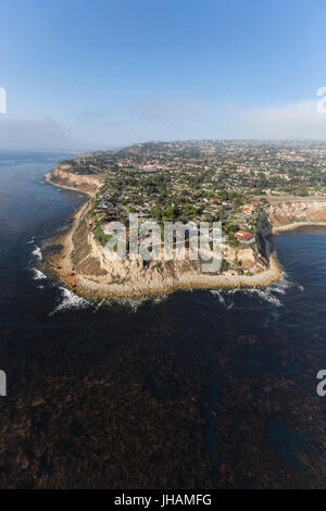 Aerial view of kelp filled pacific water at the edge of Palos Verdes and Abalone Cove in Los Angeles County, California. - Stock Photo