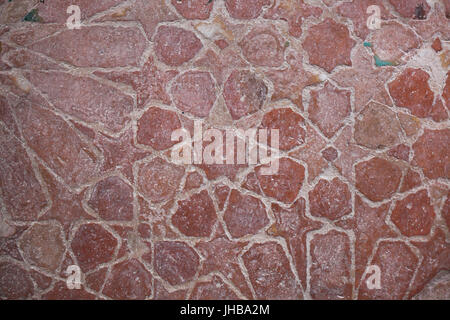 Geometric mosaic made from glazed tiles called Alicatados on the floor in the Hall of the Ajimeces (Sala de los - Stock Photo