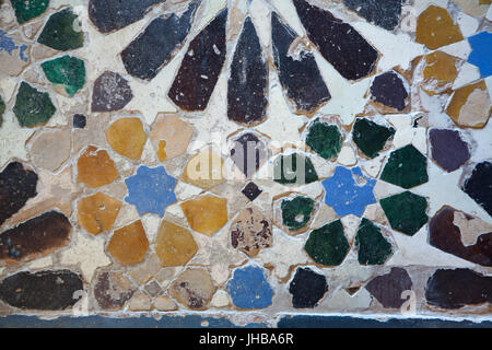 Geometric mosaic made from glazed tiles called Alicatados on the floor in the Hall of the Two Sisters (Sala de Dos - Stock Photo