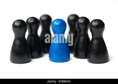 Boss, chief or team leader standing in the middle of his team. Business concept for leadership, teamwork or groups. - Stock Photo