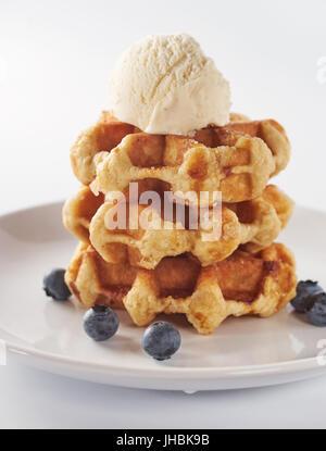 Close up of sweet waffles on white - Stock Photo