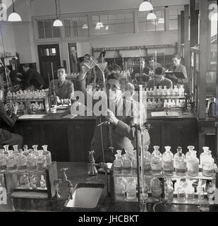 1950s, historical, school boys doing chemistry experiments in a well-stocked science laboratory at Mill Hill Public school, a traditional Briitsh boys only fee paying boarding school in North London, England, UK.
