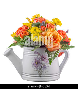 Vivid colored flowers, orange roses, in a white sprinkler, watering can, isolated, close up - Stock Photo