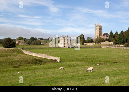 St James' Church and East Banqueting House of Campden House with grazing sheep, Chipping Campden, Cotswolds, Gloucestershire, - Stock Photo