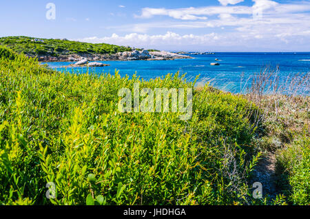 Costline with granite rocks and amazing azure water on Porto Pollo, Sardinia, Italy - Stock Photo