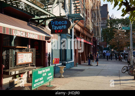 Tribeca district sidewalk with people in a sunny summer day in New York - Stock Photo