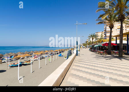 The promenade and beach called Playa Ferrara in Torrox Costa on the Costa Del Sol Spain - Stock Photo