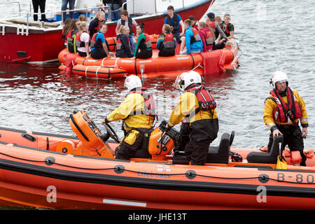 bangor rnli lifeboat jessie hillyard on safety demonstration rescuing children from liferaft northern ireland - Stock Photo