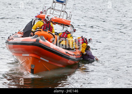 bangor rnli lifeboat jessie hillyard on safety demonstration recovering man from the sea northern ireland - Stock Photo