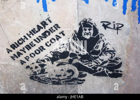 A Rich Heart May be Under a Poor Coat Graffiti Manchester, 2017 - Stock Photo