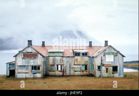 Old abandoned haunted house. Ruin at a fjord in Iceland. - Stock Photo