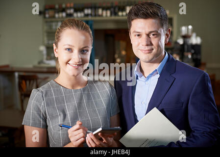 Portrait Of Owner With Waitress In Restaurant - Stock Photo