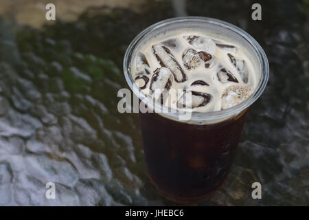 Sparkling Nitro cold brew coffee ready to drink in take away cup. - Stock Photo