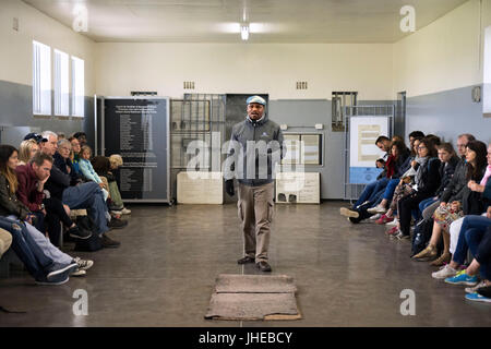 Tourists and prisioner in prisoners cell on Robben Island, Robben Island, prison grounds for political prisoners - Stock Photo