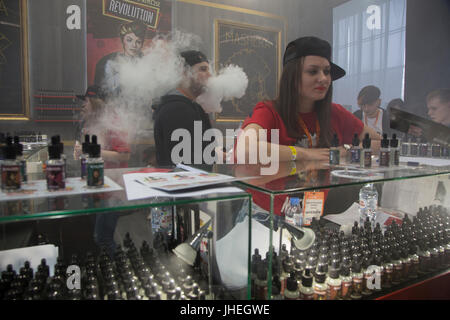 People smoke electronic cigarettes at the vape shop in Moscow, Russia - Stock Photo