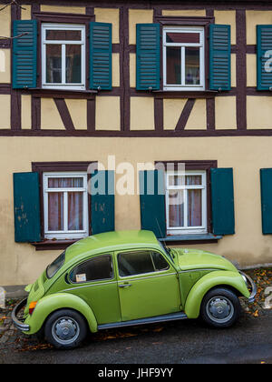 bamberg, Germany: Circa November 2015 - old vw beetle in front of a half-timber house - Stock Photo