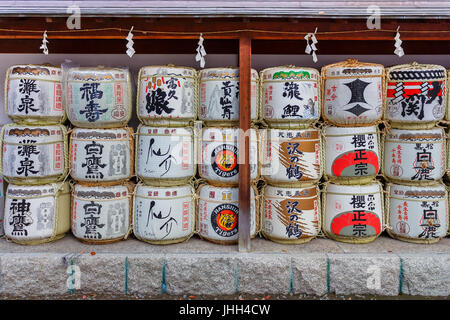 Sake barrels at Ikuta-jinja in Kobe, Japan - Stock Photo