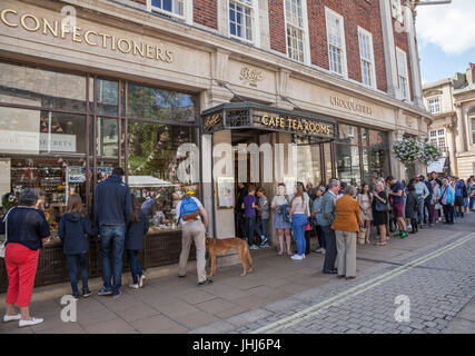 People queuing to go in Betty's Tearooms in York,England,UK - Stock Photo