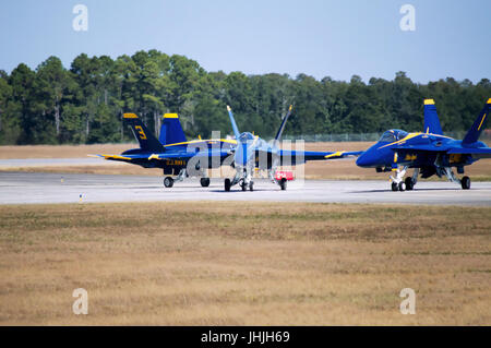 Two blue angel jets taxiing on the tarmac after landing at their home base in Florida. - Stock Photo