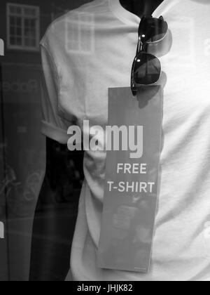 Marks and spencer window display offering free T shirt - Stock Photo