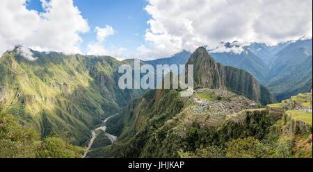 Panoramic View of Machu Picchu Inca Ruins - Sacred Valley, Peru - Stock Photo