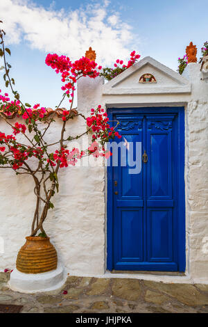 Gate with flowers in Skopelos town, Greece. - Stock Photo