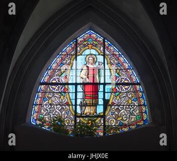 Stained glass window, depicting Saint Philomena, in the church of Saint-Félix à Portiragnes,  Hérault department, - Stock Photo