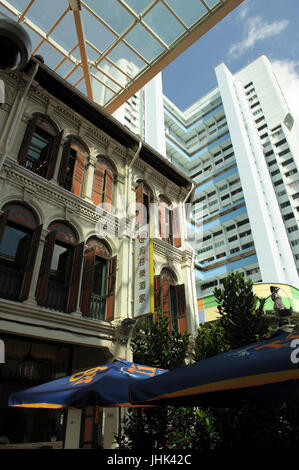 Traditional shophouses on street corner, with modern multi-storey apartment block in background, Smith Street, Chinatown, - Stock Photo