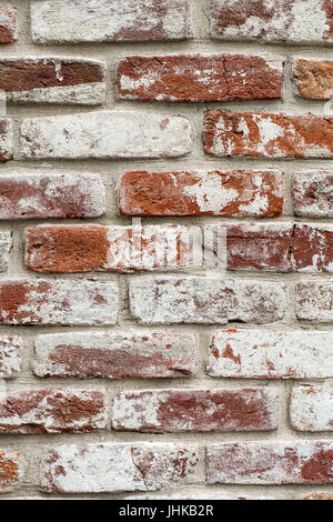 Red brick wall painted white. texture, background, design. - Stock Photo