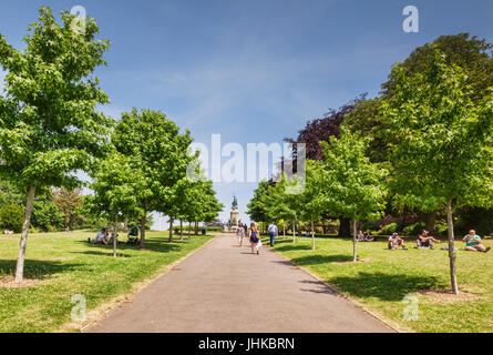 21 June 2017: Exeter, Devon, England, UK - Avenue of treees in Rougemont Gardens, Looking towards the War Memorial. - Stock Photo
