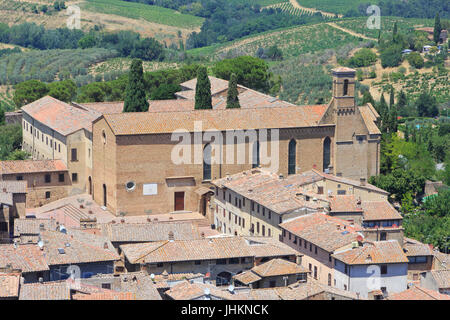 The 13th century Chiesa di Sant'Agostino (Church of St Augustine) in San Gimignano, Italy - Stock Photo