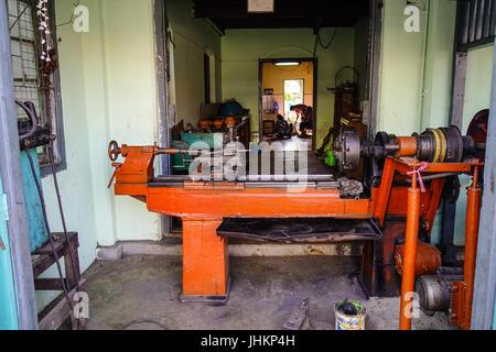 Pyin Oo Lwin, Myanmar - Feb 12, 2017. Metal working machine at the old workshop in Mandalay, Myanmar. The small - Stock Photo