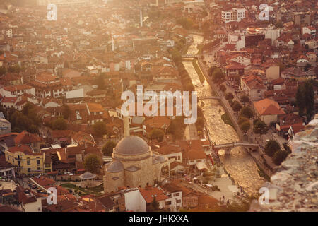 old and cultural city of Prizren, Kosovo with the golden river in the evening sunshine - Stock Photo