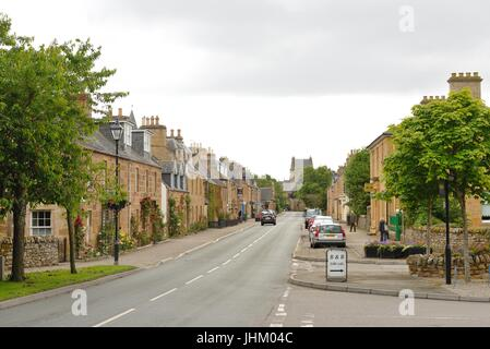 Looking down Castle Street which is the main road through the town of Dornoch in Sutherland, Scotland, UK - Stock Photo