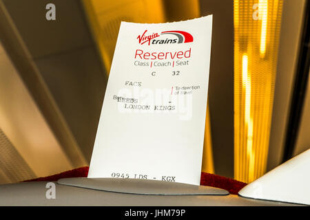 A reserved seat ticket in the seat of Virgin Trains between London Kings Cross and Leeds, England, UK. - Stock Photo