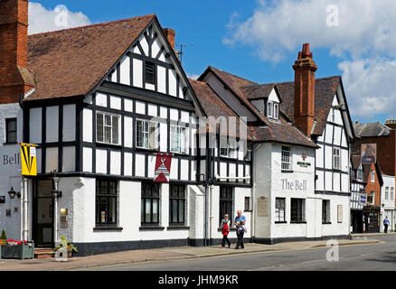 Couple walking past the Bell pub, Tewkesbury, Gloucestershire, England UK - Stock Photo