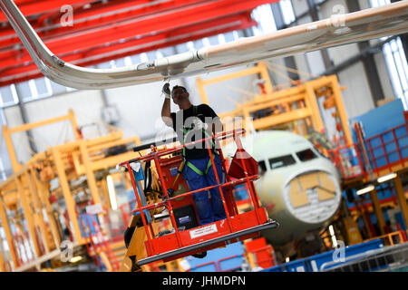 Hamburg, Germany. 14th July, 2017. Airbus employees working in the final assembly line of the Airbus A320 family - Stock Photo