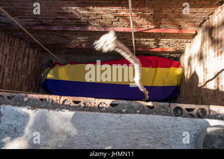 Jul 2, 2017 - Madrid, Spain - Coffin of Timoteo Mendieta inside the family grave. Covering the coffin, the flag - Stock Photo